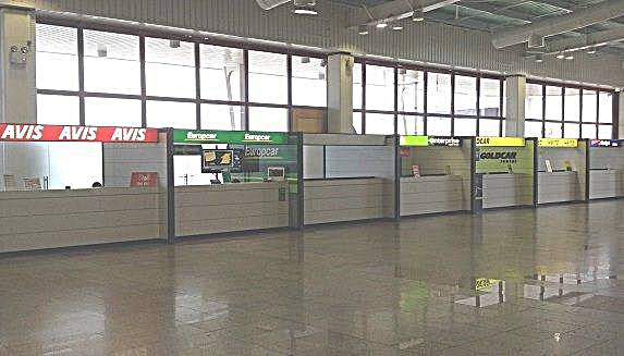 Car rental desks inside Faro Airport