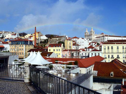Rainbow over Lisbon at Portas do Sol Miradouro