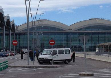 Minibus outside the Alicante Airport terminal building